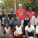 Hanson shown with a group of boys from a small South African village where he gave a basketball clinic.