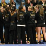 The gymnastics team sings the Gustie rouser just prior to the start of the meet.