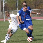 Bryan Bjork battles with Macalester's Paul Lund in Saturday's 1-1 tie.