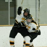 Jack Walsh and Ryan Johnson celebrate after Johnson scored to put Gustavus up 3-1 in the third period.
