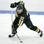 Gustavus defenseman Patrick Hurley shoots during the third period of a men's ice hockey game between Gustavus and Augsburg on December 3, 2011. Gustavus won the game 4-1 behind two second period goals by Hurley.  Photo courtesy of Caleb Williams/d3photography.com