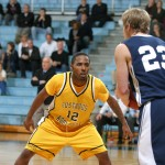 Ty Moore guards Carleton's Tom Sawatzke.