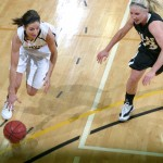 Molly Geske drives to the basket against St. Olaf's Kirstee Rotty. Geske finished with a game-high 17 points.