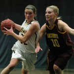Colleen Ruane drives to the basket against Paige Beseman.