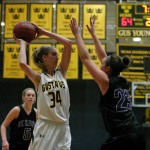 Abby Rothenbuehler looks inside to the low post against St. Catherine's Kristen Lee.
