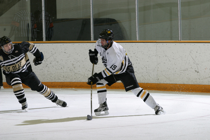 Junior Brian White looks for a window in Saturday night's 3-3 tie with St. Olaf.