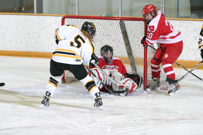 Jenna Christensen flips in a goal over Saint Ben's goalie Jenna Traut.