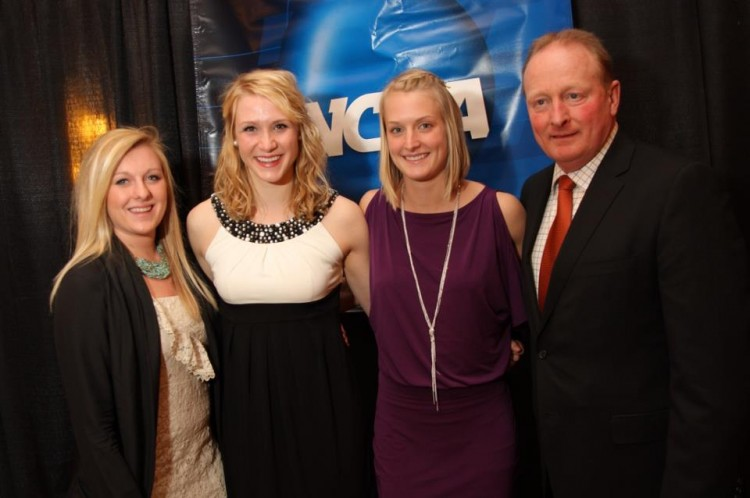 (L to R) All-Americans Mollie Carroll, Lindsey Hjelm, and Allie Schwab with Head Coach Mike Carroll at Thursday night's NCAA Championship banquet. Photo courtesy of http://www.facebook.com/HuthPhoto
