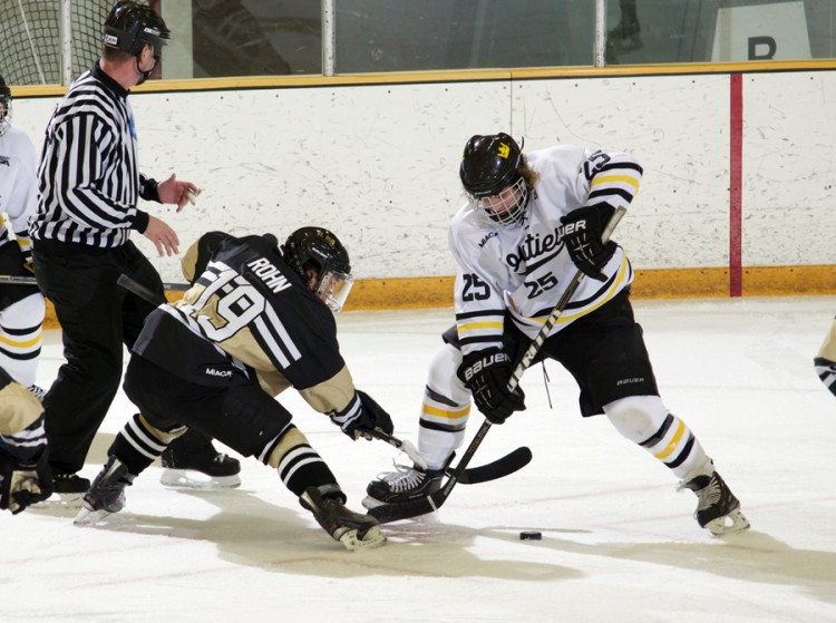 Gustavus' Ryan Johnson faces off against Peter Rohn in the last meeting between the two squads.