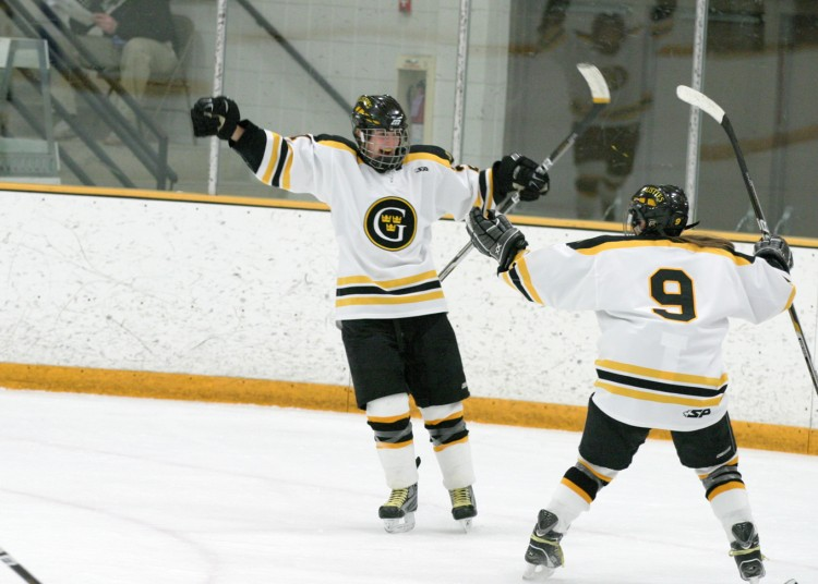 Allie Schwab and Amanda Cartony (9) celebrate after Schwab's goal to start the second period.