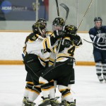 The Gusties mob Courtney Boucher after she netted the game-winner in overtime.