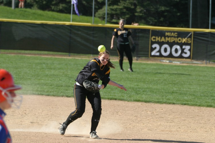 Caitlin Whitney fires over to first base.