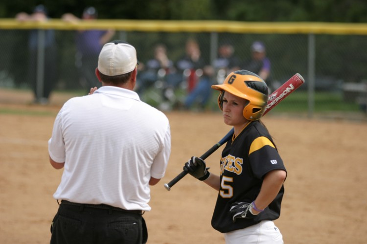 First-year third baseman Carly Klass talks with Head Coach Jeff Annis in between batters on Saturday against St. Thomas.