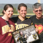 Senior Dee Dee Arnold with sister Sheila `10 and father John being honored as a part of Senior Day at the Gustie Softball Field.