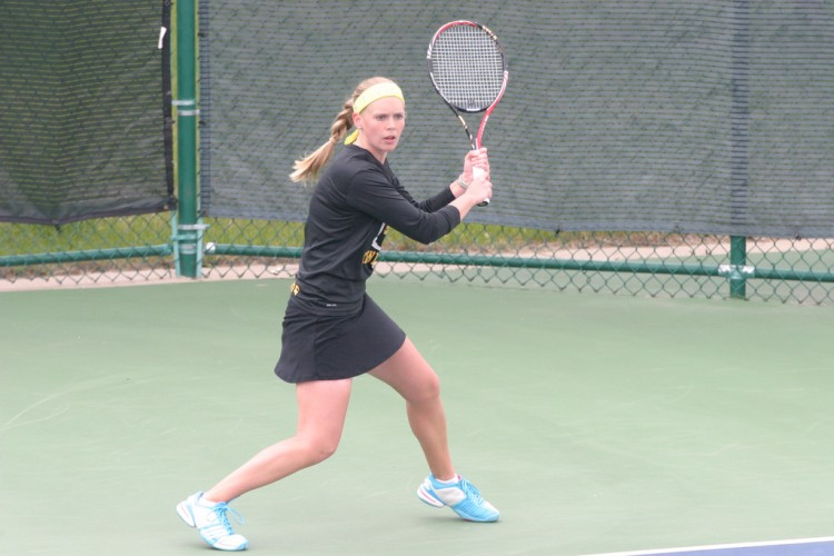 Megan Born provided the Gusties a key come-from-behind win at No. 4 singles on Sunday against Carleton.