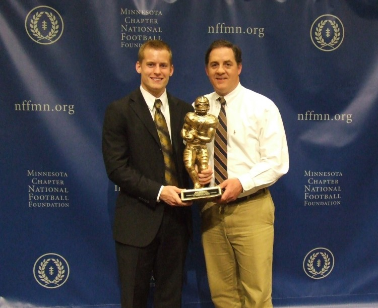 Brad Kruckeberg accepts the 2012 Bob Stein College Scholar Award alongside Head Coach Peter Haugen at Sunday's awards banquet.