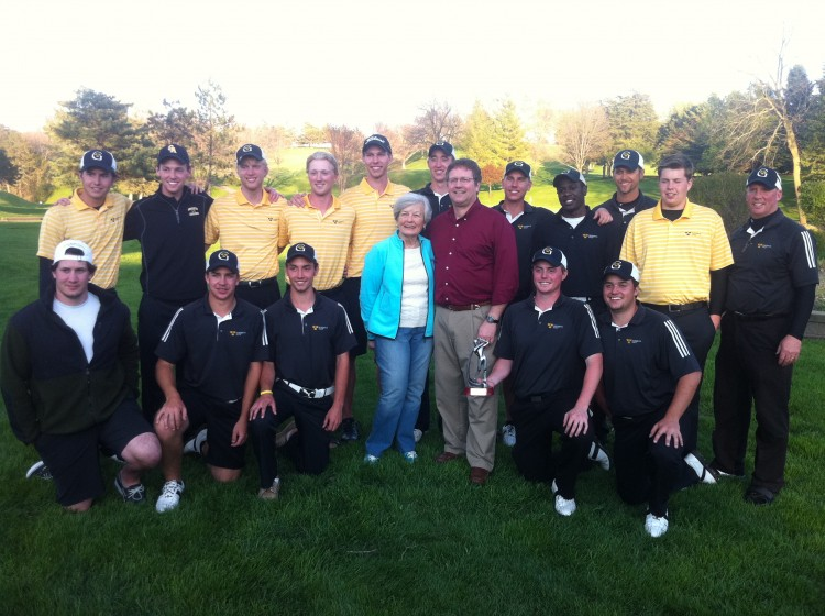 Bobby Krig Invitational Champs Gustavus with Barb and David Krig, the wife and son on Bobby Krig.