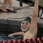 Anna Eames celebrates at the 2012 MIAC Championships.