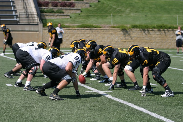 The Gustavus offensive and defensive line square off for the first time with shoulder pads on Tuesday morning.