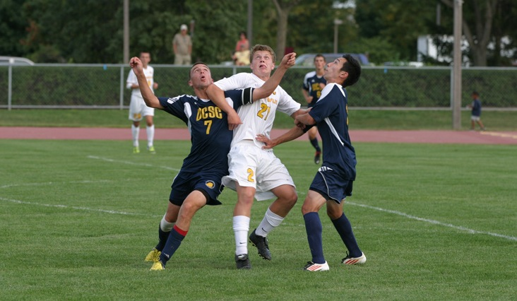 Rookie Charlie Adams battles for position against a pair of UC-Santa Cruz players.