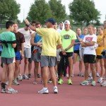 Head Coach Dale Bahr instructs his team before the morning run on Wednesday.