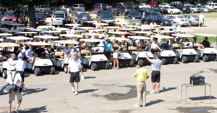 Head Coach Peter Haugen addresses more than 140 golfers before the start of the 2012 Gustie Football Alumni Golf Tournament.