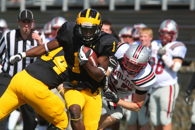 Phillip Butler runs through a tackle on Saturday against Hamline. The Gusties defeated the Pipers 37-0 for their first MIAC victory of the season. Photo courtesy of Bridget Fowler - Sport PiX.