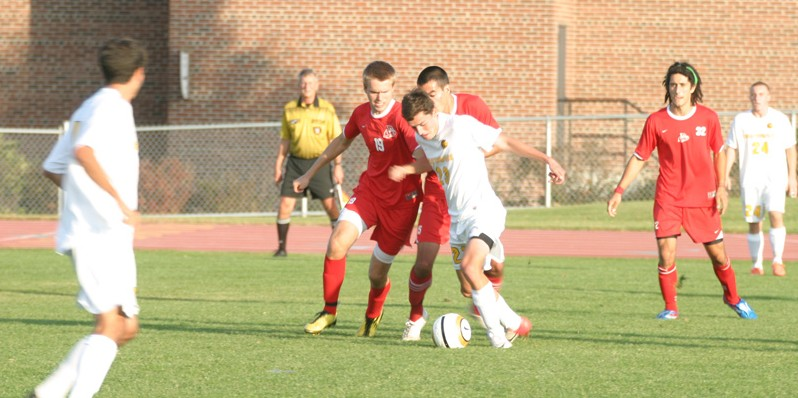 Freshman Connor Danielson battles to maintain possession against a pair of Saint Mary's defenders.