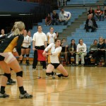 Sophomore Shelby Nosan digs out a Carleton spike on Wednesday night on Gus Young Court.