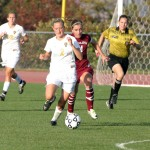 Senior Maggie Lane (Sr., Saginaw, Minn.) beats a Hamline defender in Wednesday's win.
