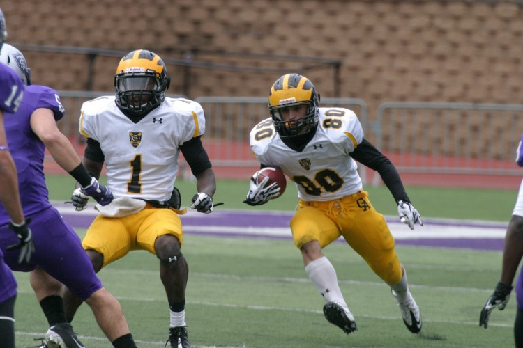 Michael Hintze looks for a lane with Phillip Butler in front leading the way on Saturday against St. Thomas.