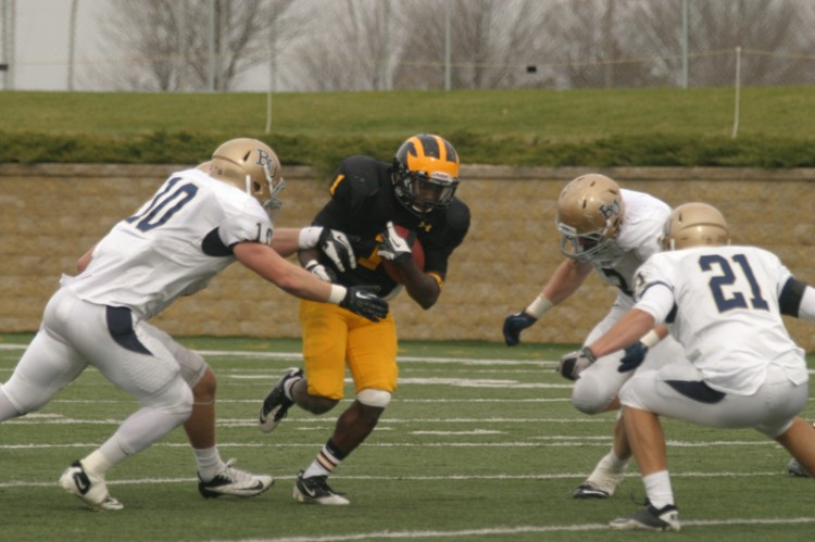 Phillip Butler looks for a hole on Saturday against Bethel.