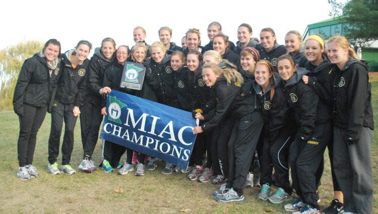 The Gustavus women's cross country team celebrates its MIAC championship (Photo courtesy of Matt Higgins, MIAC Assistant Executive Director)
