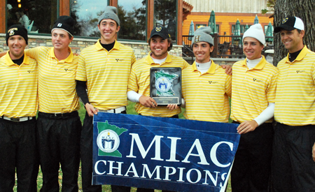 The Gustavus men's golf team poses with the championship trophy.