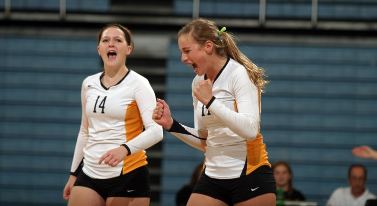 Senior Emily Phillips celebrates after a kill on Friday night against Concordia.