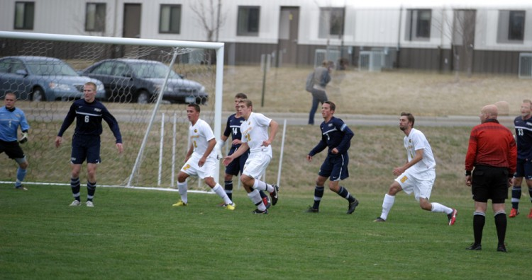 (L to R) Sean Sendelbach, Zach Brown, and Zach Schmith move into position on a corner kick opportunity.