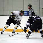 Jack Walsh tries to fire a shot past Rob Vannelli in Gustavus' 6-0 loss to St. Thomas on Friday night.