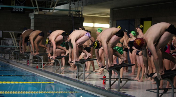 The Gustavus swimmers on the blocks just moments before beginning the Ted Mullin Hour of Power. Photo courtesy of Tyler Grey.