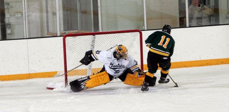 Patrick Sullivan makes the save on Kyle Stroh's penalty shot Saturday night against St. Norbert. Photo courtesy of Sport PiX.