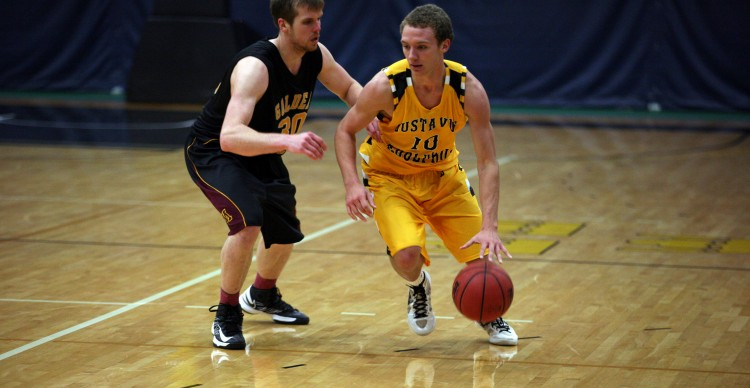 Sophomore Isaac Tapp drives past a Crookston defender on Friday night. (Photo courtesy of Andrew Vold `14, Gustavus Sports Information)