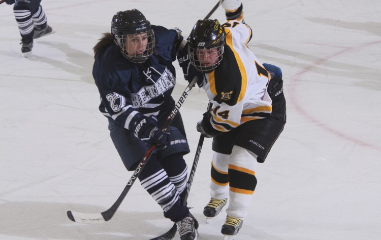 Bethel's Jill Larson (27) and Gustavus' Melissa Doyle (14) battle it out in their prior meeting in St. Peter (photo courtesy of Sport Pix Photography)