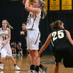 Kelsey Florian pulls up for a jumper on Monday night against St. Olaf. Photo courtesy of AJ Dahm - Sport PiX.