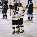Leah Johnson (15) and Allison Eder-Zdechlik (8) celebrate a Gustavus goal. (Photo courtesy of Andrew Vold `14)