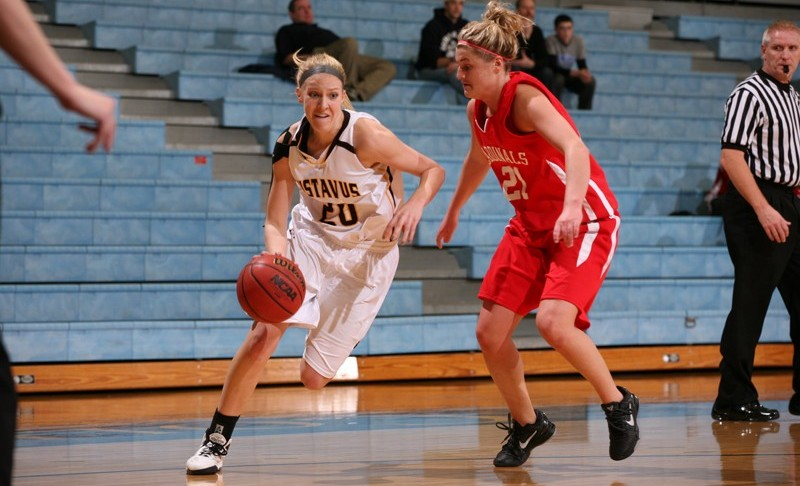 Britta Rinke drives baseline on Saint Mary's Jessica Thone Wednesday night at Gus Young Court.  Photo courtesy of Tyler Grey - Gustavus Sports Information.
