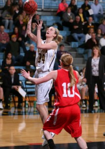 Abby Rothenbuehler goes up for a layup.