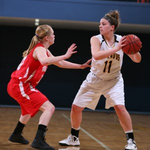 Stephanie Comer looks to the post for an entry pass. Comer finished with a season-high 19 points against the Cardinals.