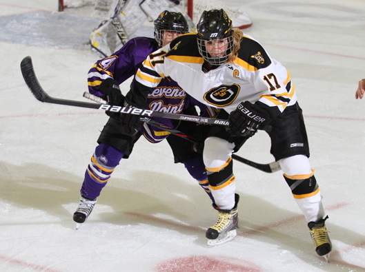 Lindsey Hjelm tallied a goal and an assist in her first game at forward this season. (Photo courtesy of Dan Coquyt `14)