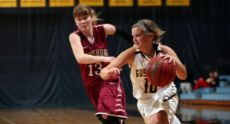 Rachelle Blaschko drives baseline on Augsburg's Abbey Luger in Wednesday night's win at Gus Young Court.