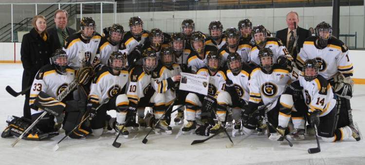 The Gustavus women's hockey team poses with head coach Mike Carroll after his 300th career victory. (Photo courtesy of Dan Coquyt `14)