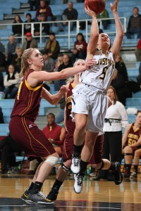 Julia Dysthe goes up for a layup over Alex Lippert.